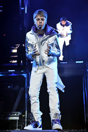Justin wears ombre purple sneakers with a studded tongue while performing on his 'My World' tour.