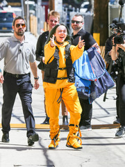 For her footwear, Billie Eilish chose a pair of yellow leather sneakers.