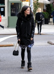 Rachel Bilson added more warmth to her dress with a pair of black tights.
