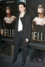 Juliette Binoche looked polished and put together in a black trenchcoat at the French premiere of 'Elle.'