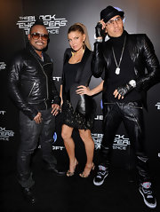 Fergie sizzled at the Black Eyed Peas launch party in a feathered LBD.