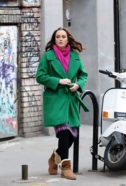 Leighton Meester brightened up her winter look with a fuchsia pashmina and Kelly green robe coat.