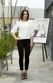 A pair of black skinny pants topped off Emily's cool and classic black and white look.