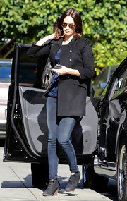 Emily Blunt maintained her simple style with a black collared coat.