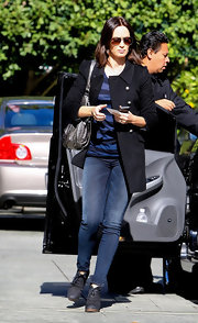 Emily Blunt kept her style casual and stylish with a pair of fitted skinny jeans.