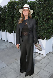 Bo Derek looked fiercely stylish in a charcoal pantsuit at the Qatar Prix de l'Arc de Triomphe.