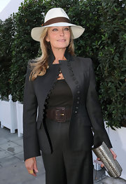 Bo Derek got a little sun protection from a white and brown fedora.