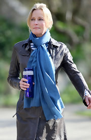 Bo Derek added a nice pop of color to her outfit with a blue scarf.