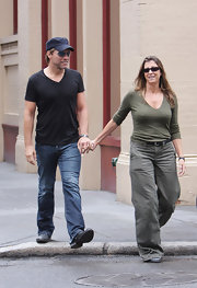 Dorothea chose baggy wide legged khakis for a casual stroll with hubby Jon Bon Jovi. She paired the loose pants with a fitted olive top.