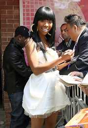 Brandy's cool, acrylic hoops look hot as she signed autographs outside of the 'The Wendy Williams Show'.