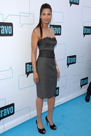Padma Lakshmi teamed her gray pencil dress with black knotted platform peep toes.
