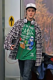 Cameron Bright wore an eclectic outfit topped off with a plaid flannel shirt.