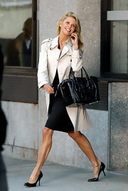 Another day on the set  and Christie looks amazing while carrying this black patent leather tote.
