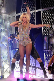 Britney glittered on stage wearing a bedazzled bodysuit and fishnet stockings.