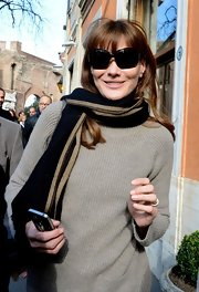 Carla Bruni-Sarkozy shopped in style with a classic striped scarf draped over her neck and shoulders.