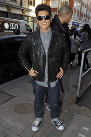 Bruno is right on trend in a leather jacket and converse shoes at the BBC Radio One studios.