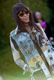 Naomi Campbell arrived for the Burberry London in Los Angeles show wearing '70s-chic oversized sunnies.
