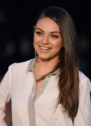 Mila Kunis wore her hair long, straight, and swept to the side when she attended the Burberry London in Los Angeles show.