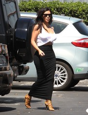 Kim Kardashian kept the sexy vibe going with a tight black maxi skirt by Givenchy.