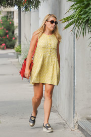 Busy Philipps kept it easy-breezy in a yellow baby doll dress while out and about.