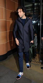 Mika stepped out in a stylish hooded wool coat after dining with Fergie and Josh Duhamel in London.