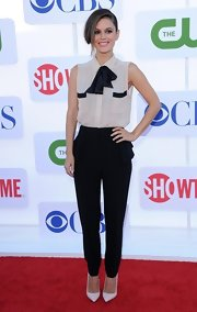 Rachel Bilson finished off her buttoned-up black-and-white look with a perfectly pink ShoeMint pump.