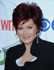 Sharon Osbourne topped off her look with a trendy razor cut.