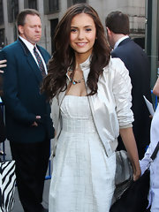 Nina Dobrev modernized her girly white dress with a ruched-sleeved jacket.