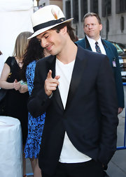 Ian looks dapper in a blue blazer with black satin lapels.