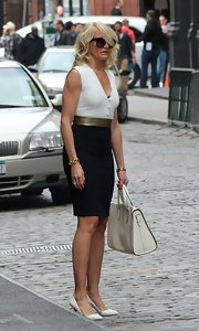 Cameron Diaz kept her look class a chic with this black pencil skirt that featured a gold belt.