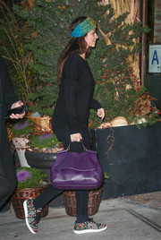 Camila Alves completed her look with a stylish purple leather tote.