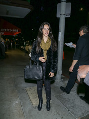 Camila Cabello finished off her dark ensemble with a black leather tote.