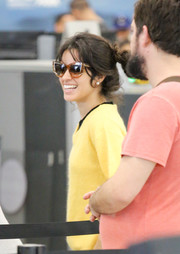 Camila Cabello was seen at LAX wearing a pair of Thierry Lasry cateye sunnies.