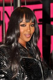 Naomi Campbell attended the Renault launch party in Paris wearing her hair in long layered waves with straight wispy bangs.