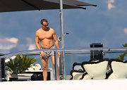Wealthy magnate Vladimir Doronin sported striped swim trunks while vacationing with Naomi Campbell.