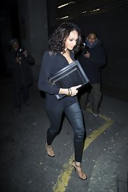 Alesha Dixon attended the James' Jog-On to Cancer event carrying an oversized textured black clutch.