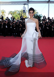 Sonam Kapoor attended the premiere of 'The Artist' at the Cannes Film Festival in a sheer one-shoulder dress. A sleek updo and smokey eye shadow completed her look.