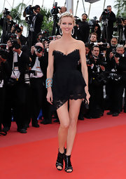 Model Eva Herzigova showed off her perfectly proportioned figure while hitting the Cannes Film Festival.