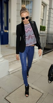 Cara Delevingne stepped out in London looking cool in blue leather skinnies, a tux jacket, and a crop-top.