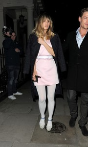Suki Waterhouse enjoyed a night out in London wearing an embroidered black coat over a pink mini dress.