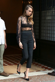 Cara Delevingne opted for simple yet classic footwear with a pair of black patent platform pumps by Christian Louboutin.