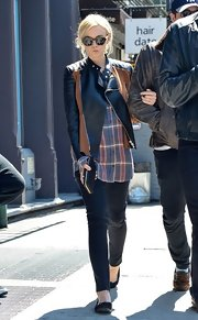 Carey Mulligan chose a black leather jacket with brown trim for her cool and edgy daytime look while out in NYC.
