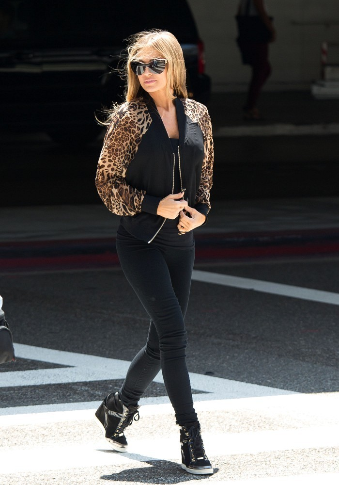 Carmen Electra looks stunning at the crosswalk as she arrives at LAX (Los Angeles International Airport).