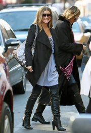 Carmen strutted her stuff in a chic pair of scrunched leather over the knee black boots with skinny jeans and a patterned black coat.