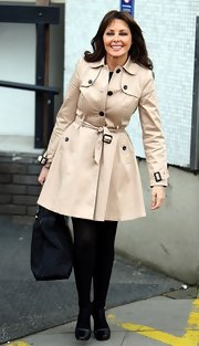 Carol Vorderman's belted trenchcoat gave her a classic and feminine look at studios in London.