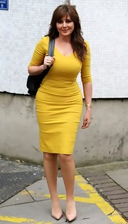 Carol Vorderman showed off her figure with a mustard yellow day dress.