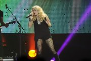 Carrie Underwood performed in this asymmetrical loose blouse while in London.