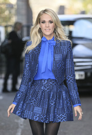 Carrie Underwood looks polished in this royal blue skirt suit with a satin pussybow blouse underneath.