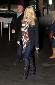 Carrie kept warm with a chevron print scarf.