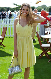 Petra Nemcova gave contrast to her sunny yellow chiffon dress at  Cartier Polo 2011 with a metallic silver quilted bag with a silver chain strap.
